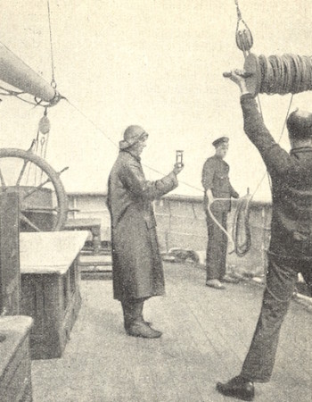 Apprentices on a sailing ship 'streaming the log'